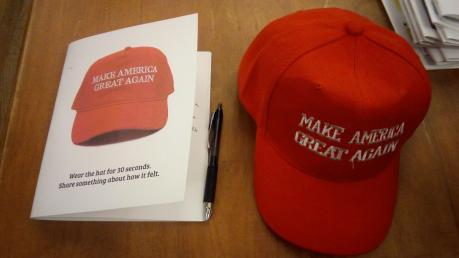 MAGA hat and reflection.png
